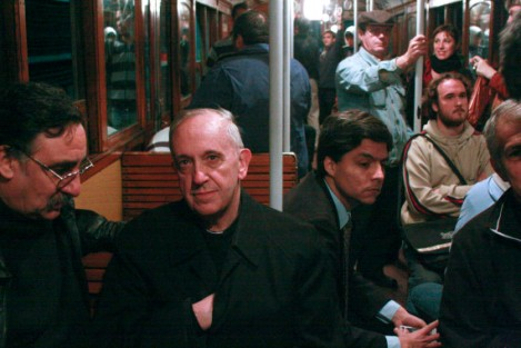 Argentina's Cardinal Jorge Mario Bergoglio, second from left, travels on the subway in Buenos Aires, Argentina. Via HuffingtonPost