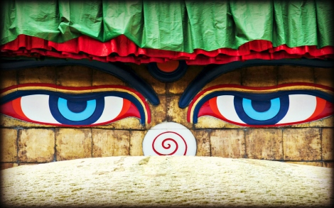 Close up of the piercing blue eyes of the Buddha on the Boudhanath Stupa just outside of Kathmandu, Nepal.