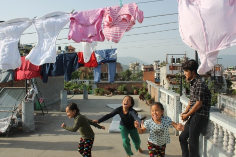 Photo of children playing on a rooftop in Kathmandu a week after The Great Earthquake of April 24, 2015. Photo by Cathleen Falsani for Religion Dispatches.